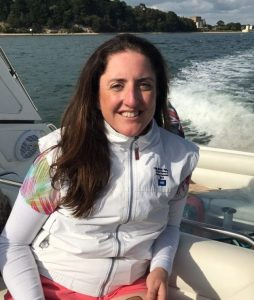 Chiropractor Karen Oldale from Back In Form Chiropractic Clinic relaxing on friends Sunseeker.